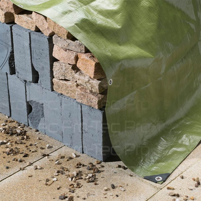 Green Tarpaulin covering bricks
