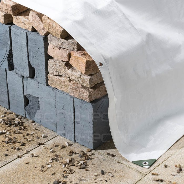 Picture White Tarp covering bricks